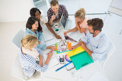Young design team going over photography contact sheets together Royalty Free Stock Images