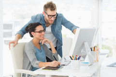 Young design team working at desk Royalty Free Stock Image