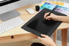 Young designer drawing sketches. On graphic tablet Stock Photos