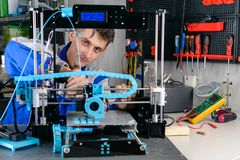Young designer engineer using a 3D printer in laboratory stock photos