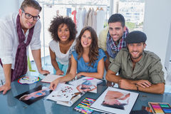 Young designers smiling at camera royalty free stock photo