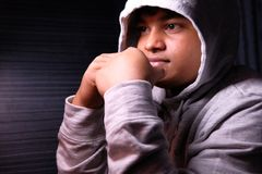 Young desperate boy wearing hood in deep depression , Royalty Free Stock Images