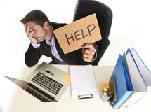 Young desperate businessman suffering stress working at office c Stock Image