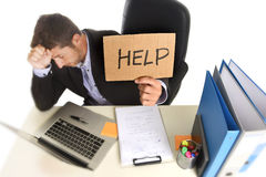 Young desperate businessman suffering stress working at office c Stock Photography