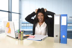 Young desperate businesswoman suffering stress working at office computer desk Stock Photos