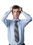 Worried businessman. Looking puzzled while scratching his head Royalty Free Stock Photo