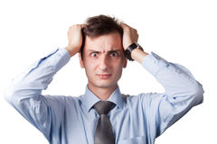Stressed businessman. Portrait of stressed businessman with hands on head, white background Royalty Free Stock Photos