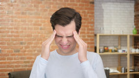 A young desperate man having headache , frustraion stress. High quality Royalty Free Stock Photography
