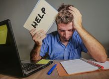 Young desperate and stressed businessman feeling overwhelmed working with laptop computer at office desk sad suffering stress aski stock photos