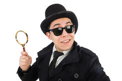 Young detective in black coat holding magnifying Royalty Free Stock Photography