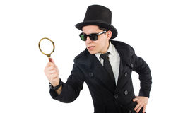 Young detective in black coat holding magnifying Stock Images