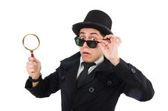 Young detective in black coat holding magnifying Royalty Free Stock Images