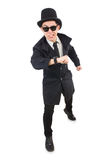 The young detective in black coat isolated on white Stock Images
