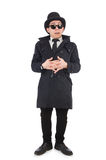 The young detective in black coat isolated on white Royalty Free Stock Photos