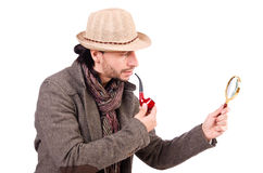 Young detective with pipe. And magnifying glass stock images
