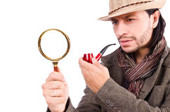 Young detective with pipe. And magnifying glass stock photography