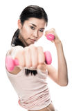 Young determined woman holding small dumbbells Stock Photo