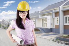 Young developer with blueprint at residential site Stock Image