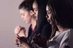 Young Devoted Women Praying Together. Three Dedicated Christian Ladies Praying To God Stock Image