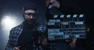 Young director giving instructions on a film set stock photography