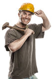 Young dirty Worker Man With Hard Hat helmet  holding a hammer Royalty Free Stock Photo