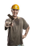 Young dirty Worker Man With Hard Hat helmet  holding a hammer Royalty Free Stock Image