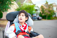 Young disabled boy in wheelchair looking up into sky Royalty Free Stock Photography