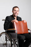 Young disabled business man in wheelchair Stock Image
