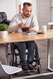 Young disabled guy enjoying his morning meal Stock Photography