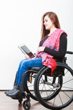 Young disabled lady with tablet. Stock Image