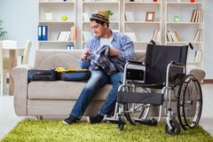 The young disabled man preparing for summer vacation Royalty Free Stock Photos