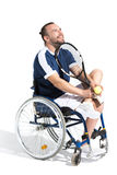 Young disabled tennis player sitting in wheelchair and smiling Stock Image