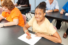 Young Disabled Woman in College. Young woman with cerebral palsy in college class Royalty Free Stock Photography