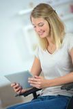 Young disabled woman using tablet computer Royalty Free Stock Photography