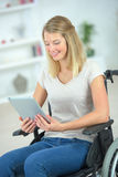 Young disabled woman using tablet computer Stock Image