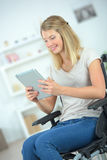Young disabled woman using tablet computer Stock Photography