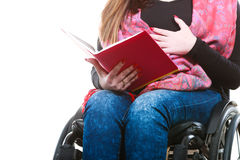 Young disabled woman in wheelchair with book. Stock Photography