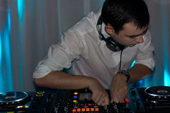 Young disc jockey working in a nightclub Royalty Free Stock Photos
