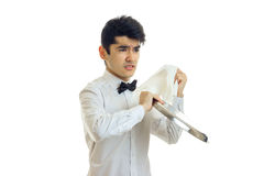 Young disgruntled waiter rub towel tray for cupboards and angry Royalty Free Stock Photography