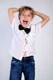 Young disheleved boy stock photo