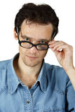 Young disheveled man in glasses Royalty Free Stock Photography