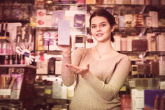 Young displaying variety of perfume Royalty Free Stock Image