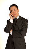 Young dissatisfied businessman with cellphone Stock Photos