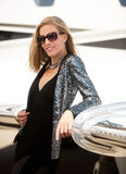 Young Diva with Private Jet. Young diva leaning on private jet wing Royalty Free Stock Photo