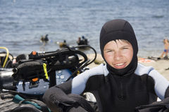 Young diver. On the sea beach, near scuba gear Royalty Free Stock Image