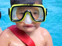 A young diver. A young boy in the water with scuba diving equipment Stock Images
