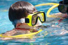 A young diver. A young boy in the water with scuba diving equipment Stock Photos