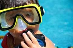 A young diver. A young boy in the water with scuba diving equipment Royalty Free Stock Image