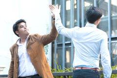 Young Diverse Asian Business Men Giving High Five Stock Photo