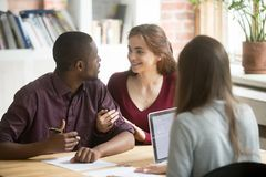 Young biracial diverse couple consulting before signing mortgage Stock Images
